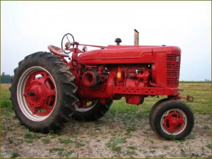Image of a tractor in a field, possibly one of the vintage tractors